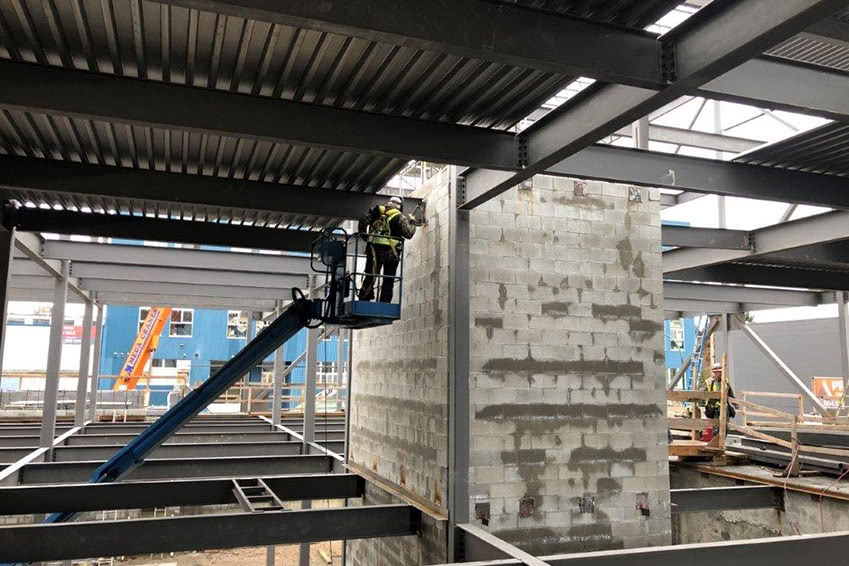 Masonry work done on the elevator shaft on the NationWide Pender facility