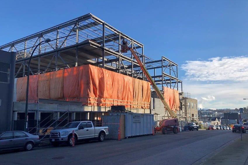 Tarps and temporary heating installed on the second floor of the NationWide Pender facility