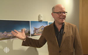 Stephen Creighton of Dymon Storage shows off drawings to CBC news of new facilities the company has under construction in Toronto