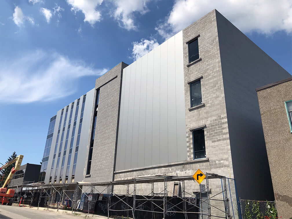 Pender property – cladding and windows complete