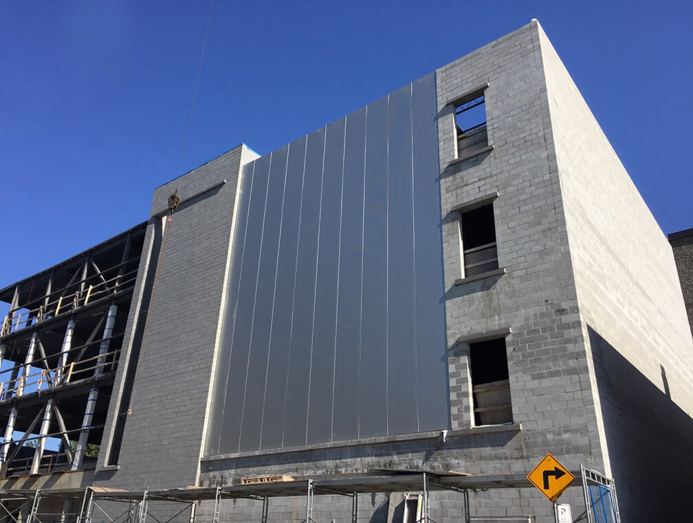 Pender property – metal cladding in progress for the south wall corner
